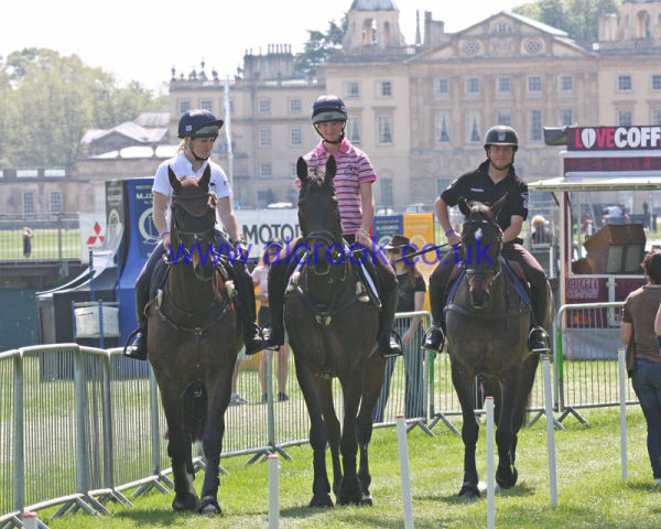 British young eventers Laura Collett, Georgie Spence, & Ben Hobday exercising their horses