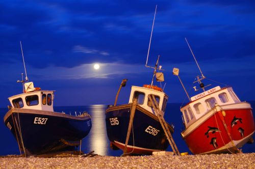 Three boats on the beach