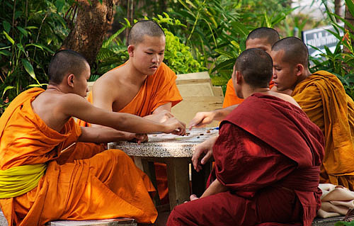 Playing chess in monastery courtyard