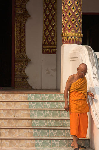 Monk leaving temple Chiang Mai