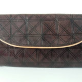 Embossed Dark Brown Leather Purse with Cream Piping by Abas Koanda