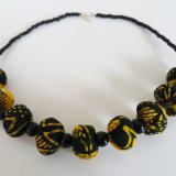 Black and yellow textile and bead necklace by Rasmata Ouedraogo