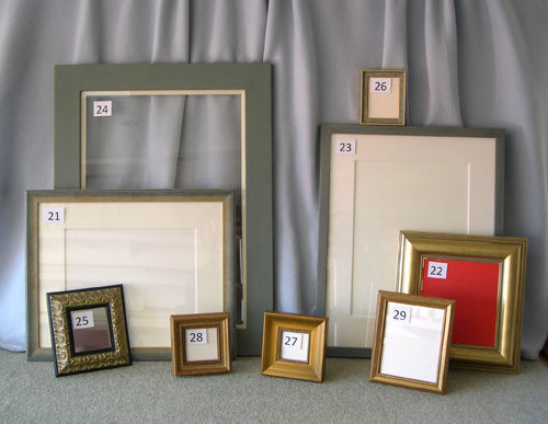 FIVE PHOTO FRAMES AND FOUR OTHERS