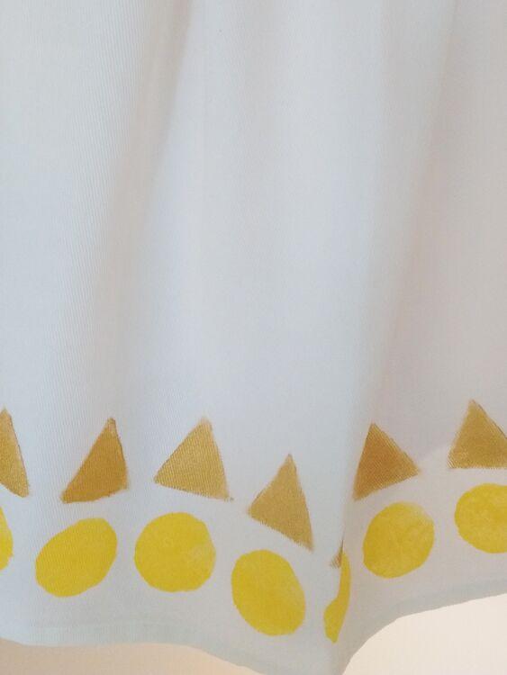 Circles Triangles (gold) tea towel