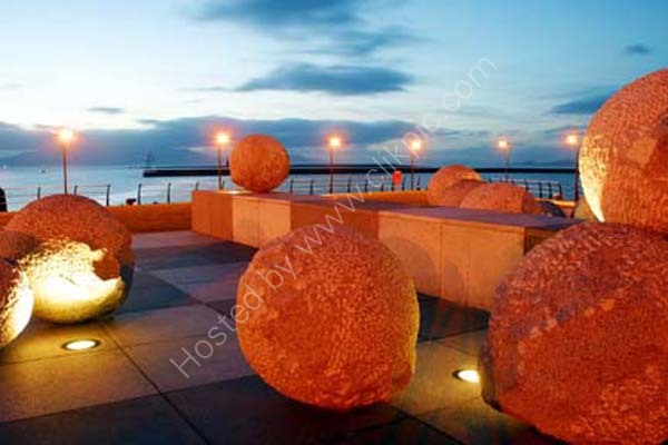 Ardrossan Harbour at dusk showing art work