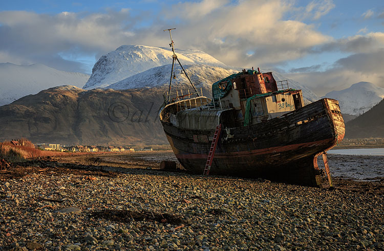 Abandoned fishing boat with Ben Nevis