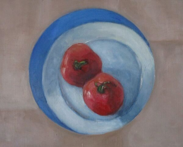 Tomatoes on a plate viewed through a circle ©