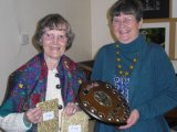 Penny Horseman receiving the trophy from Joan Robinson. Joan herself was awarded 2nd and 3rd places.