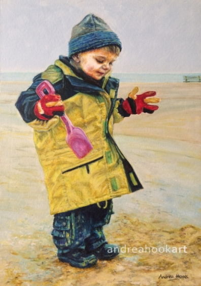 A portrait of a small boy playing on the beach in winter with a coat and borrowed gloves that are too big by Andrea Hook