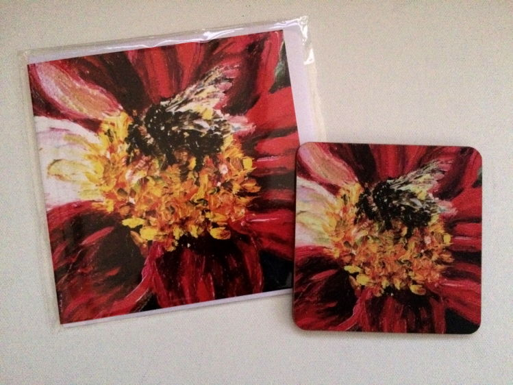 Buff-tailed Bumble bee on red dahlia coasters