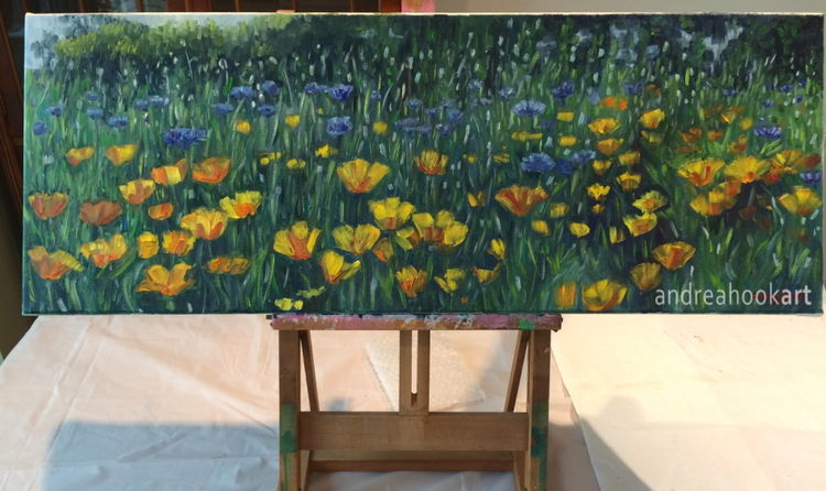 Yellow & Blue wildflower impasto painting on a tabletop easel