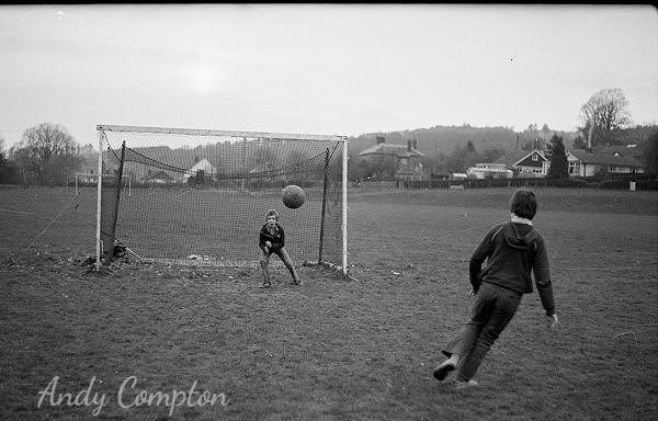 Kids playing football in 1980