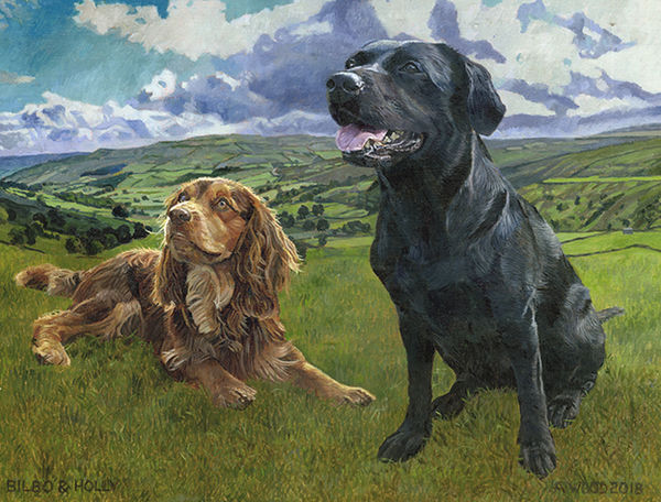 A golden cocker spaniel and a black labrador on a background of a beautiful landscape