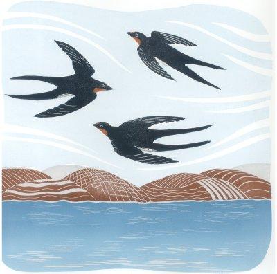 Three Swallows in Flight