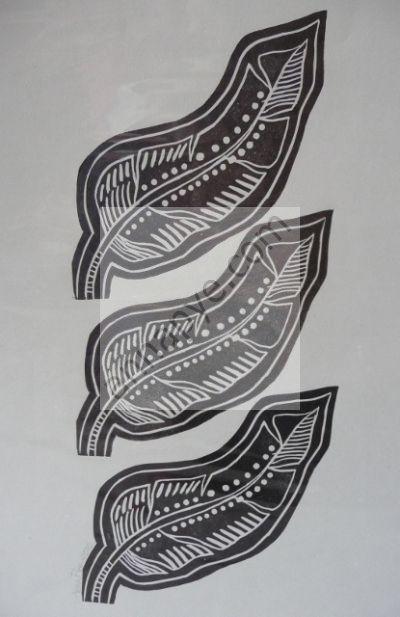 3 Guinea fowl feathers