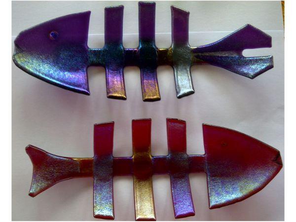 Fused and slumped iridised fish bowls