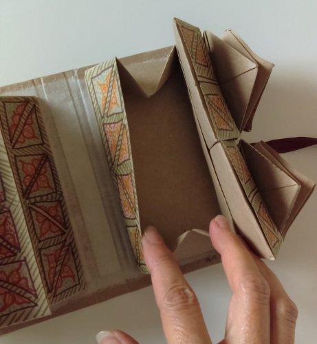Rectangular box below square boxes open