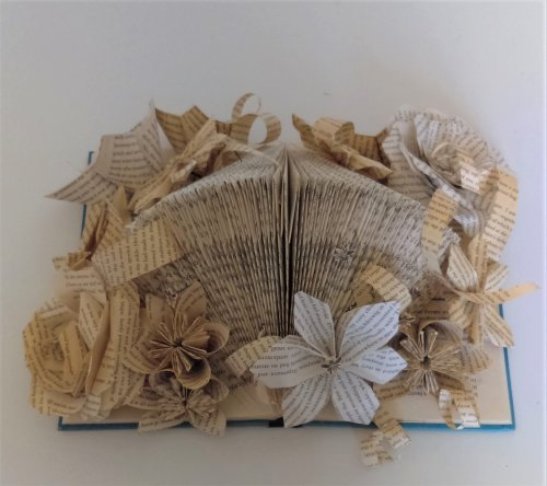 Open book with mixed flowers