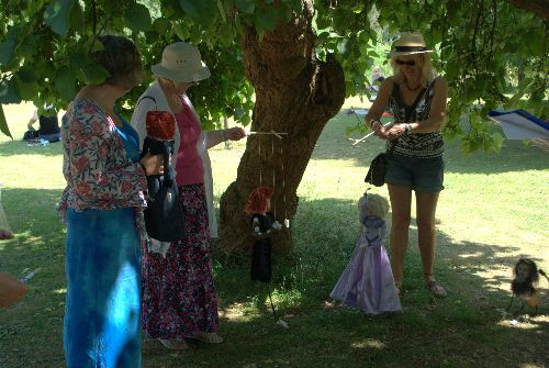 Performing a puppet show under the Black Mulberry tree.