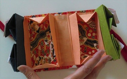 Orange boxes at bottom lined with patterned paper.