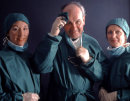 SURGEON  WITH THEATRE NURSES