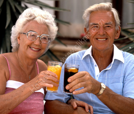 RETIRED COUPLE RELAXING WITH A DRINK