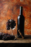 RED WINE BOTTLE WITH GRAPES IN A GLASS