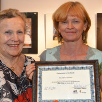 Ludmilla receives her certificate for coming first from President, Mary McClay