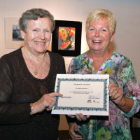 Christine Hill receives her winner's certificate from President, Mary McClay