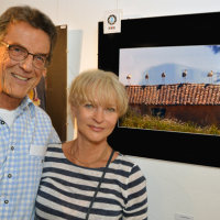 "Hubert Flasch (pictured with his wife) was voted 2nd in the public vote for his image, ""Parade of Storks"""