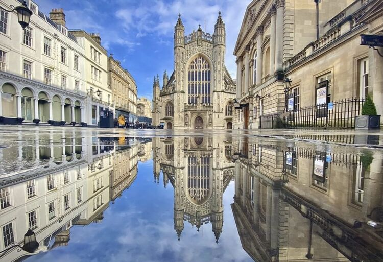 Reflections of Bath Abbey and the Pump Rooms