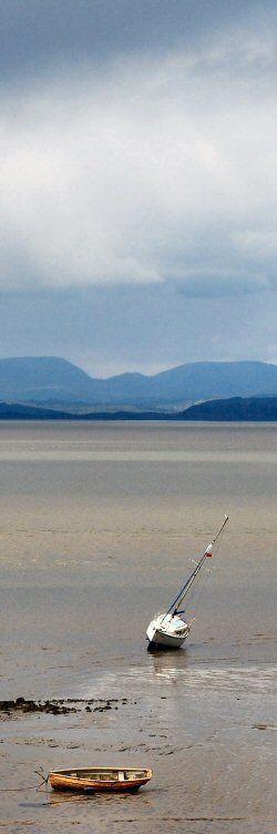 morecambe bay towards the lakeland hills with boats