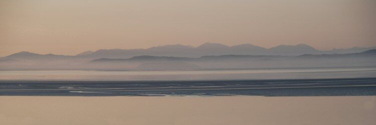 morecambe bay towards the lakeland hills in mist