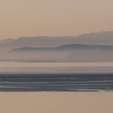 morecambe bay towards the lakeland hills in mist