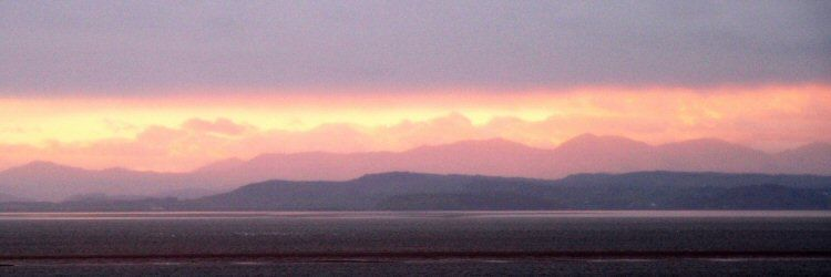 morecambe bay towards the lakeland hills at sunset