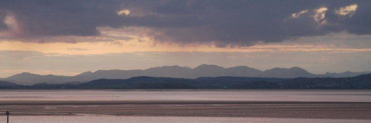 morecambe bay towards the lakeland hills at dusk