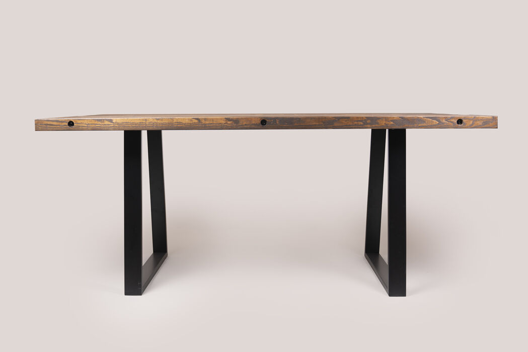 Rustic dining table with trapezium legs