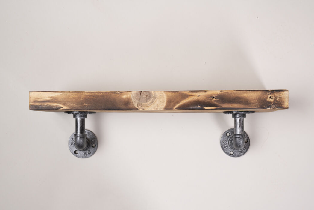 reclaimed wooden shelf with industrial brackets clear wax