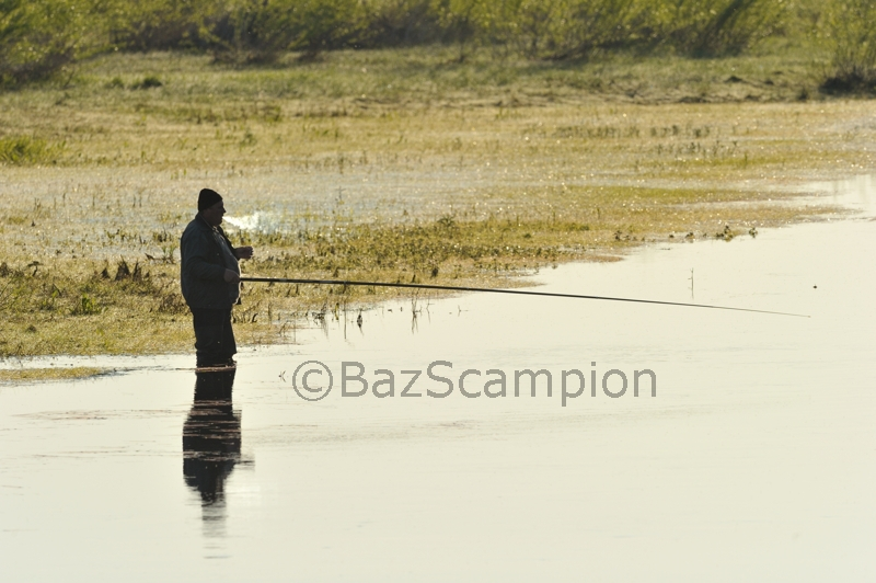 Belorussian man Fishing 'having a fag'