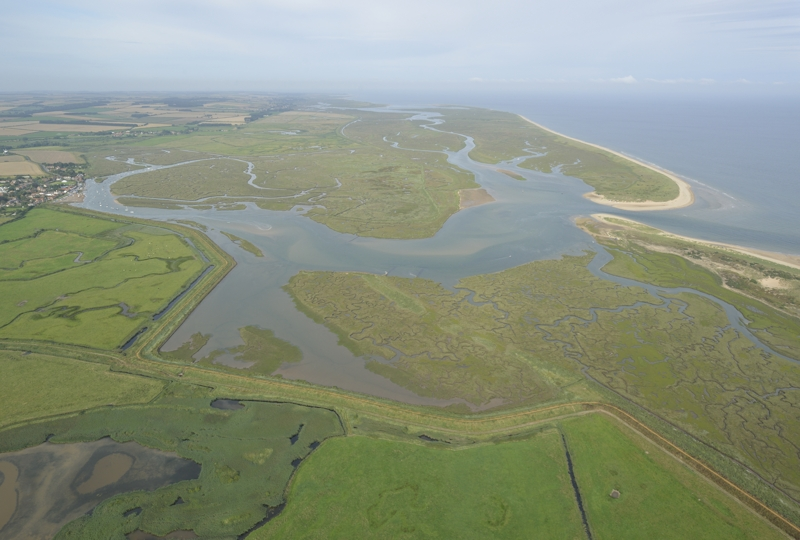 Aerial view of Burnham Overy Harbour the East end of Scolt Head Island and Gun HIll