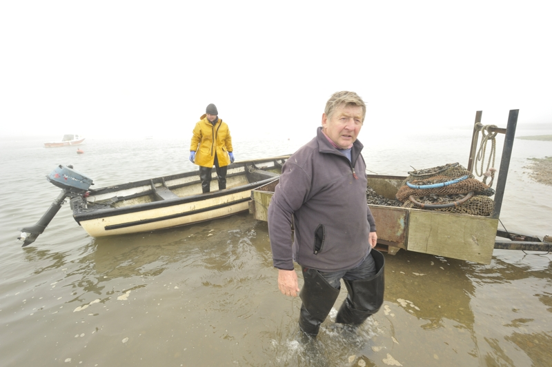 Cyril and Ben Southerland unloading Mussels at the Staithe