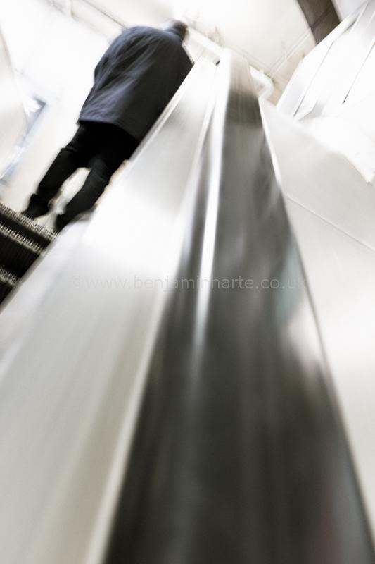 Man-on-escalator©BenjaminHarte