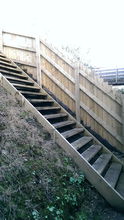 Bespoke 17 tread timber steps built on site, galvanised fixings bolted to concreted posts,  steps finished with wire mesh to avoid slipping