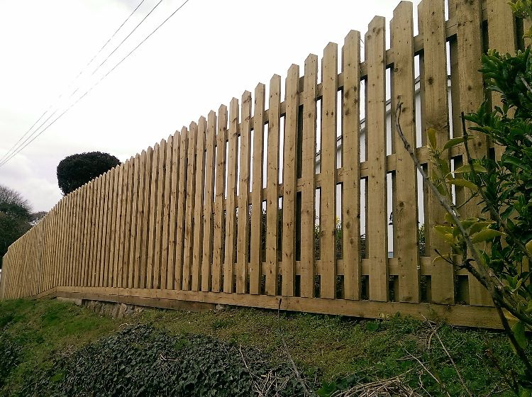 this type of hit & miss fence allows the wind to pass through whilst maintaining privacy