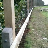 timber posts bolted to concrete spurs preventing  the posts from rotting