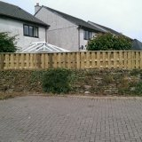 Wall top hit & miss fence with capping