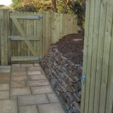 Alteration of small garden, gates, fencing, walling & paving.