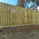 Hit & miss fence with gravel board & capping rail