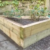 Angled raised bed built from sleeper style timber