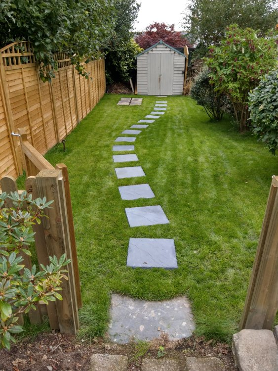 ....After, garden cleared, new fence, turf, paving stones and timber gate